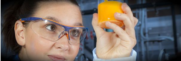 A food scientist studies an interesting mixture of food-grade chemicals.