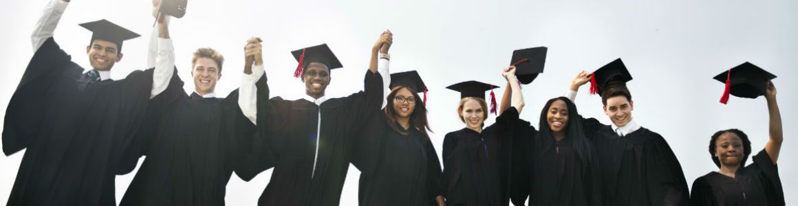 diverse group of grads celebrating graduating from college
