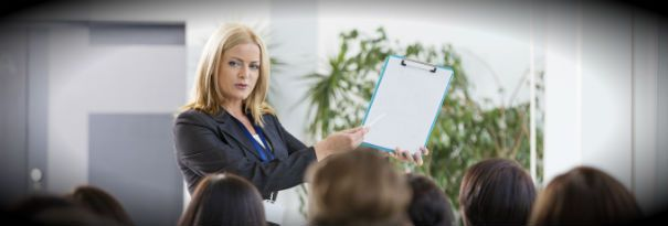 A corporate trainer leading a business training seminar.